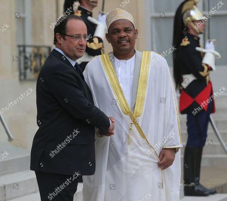 Francois Hollande, Ikililou Dhoinine France's President Francois Hollande, left, welcomes Union of Comoros President Ikililou Dhoinine, right, for bilateral talks at the Elysee Palace in Paris