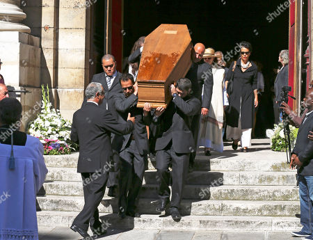 """Pallbearers carry the coffin of lawyer Jacques Verges outside St. Thomas d'Aquin church, in Paris, . Jacques Verges, who earned the nickname the """"Devil's advocate"""" for his defense of former Nazis, terrorist bombers and notorious dictators and their aides, died Aug. 15, 2013 of cardiac arrest in Paris. He was 88"""