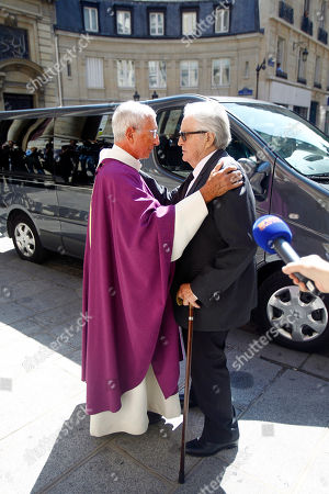 """Former French foreign minister and lawyer Roland Dumas, right, is greeted by father Alain de La Morandais, at his arrival for the funeral of lawyer Jacques Verges at the St. Thomas d'Aquin church, Paris, . Jacques Verges, who earned the nickname the """"Devil's advocate"""" for his defense of former Nazis, terrorist bombers and notorious dictators and their aides, died Aug. 15, 2013 of cardiac arrest in Paris. He was 88"""