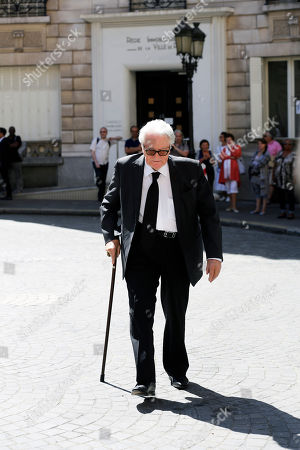 """Stock Image of Former French foreign minister and lawyer Roland Dumas arrives for the funeral of lawyer Jacques Verges at the St. Thomas d'Aquin church, Paris, . Jacques Verges, who earned the nickname the """"Devil's advocate"""" for his defense of former Nazis, terrorist bombers and notorious dictators and their aides, died Aug. 15, 2013 of cardiac arrest in Paris. He was 88"""