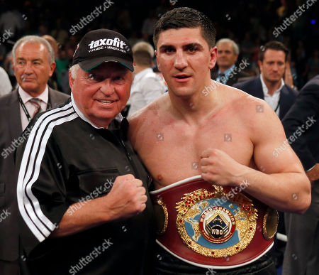 Marco Huck Germany's Marco Huck, right, and his coach Ulli Wegner pose for the photographers after winning the WBO cruiserweight championship title bout against Britain's Ola Afolabi, unseen, in Berlin, Germany, . Huck retained his WBO belt by defeating Afolabi by majority decision on Saturday