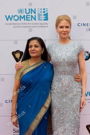 Stock Image of Nicole Kidman, Lakshmi Puri Actress Nicole Kidman, left, and the acting head of UN Women Lakshmi Puri attend the Cinema For Peace fundraising dinner in Berlin, Germany