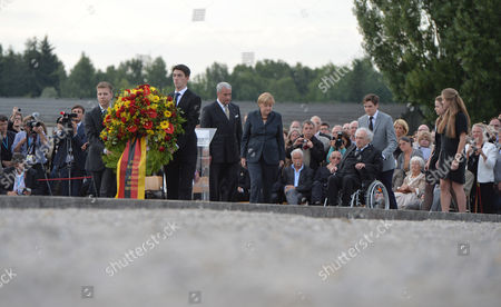 Angela Merkel,Max Mannheimer German Chancellor Angela Merkel, center, and Max Mannheimer, in wheelchair, a ttend wreath laying ceremony at the concentration camp Dachau where more than 43,000 persons were murdered and over 200,000 were imprisoned during the Nazis' terror reign from 1933-1945 in Dachau, southern Germany, on Tuesday, Aug.20, 2013. She was invited by a former inmate, 93-year-old Max Mannheimer, who was liberated from Dachau by American soldiers in 1945. Merkels' visit Tuesday evening was the first by a German chancellor to Dachau