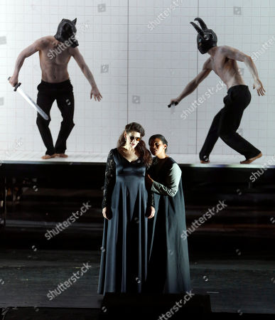 "Anja Harteros In this picture taken, Anja Harteros in the role of Leonora, left, sings during a dress rehearsal for the opera ""Il Trovatore"" by Giuseppe Verdi in the Bavarian State Opera House in Munich, southern Germany. This wild new production by Olivier Py opened the company's annual Munich Opera Festival. It's a non-stop barrage of nightmarish images mixing styles and periods that assault the audience at lightning speed on a multi-tiered revolving set"