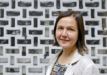 Stock Photo of Olga Chernysheva Russian artist Olga Chernysheva stands in front of her photograph 'Compossibilities' (2013) during a press preview at the exhibition 'Compossibilities' of in the Kunsthalle (Art Hall) in Erfurt, central Germany, . In cooperation with the V-A-C Foundation Moscow, the Kunsthalle Erfurt is presenting the first major solo exhibition of Olga Chernysheva's works in Germany. In addition to aquarelles, drawings and paintings from recent years, the exhibition also includes photos and numerous videos, as well as several new works. The exhibition starts on July 4, 2013 and last until Aug. 25, 2013