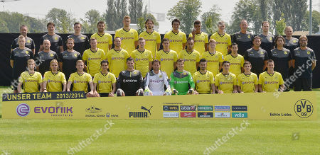 Dortmund's soccer team poses during a team photo shooting of Borussia Dortmund for the new Bundesliga season 2013/2014 in Dortmund, Germany,. Back row from left: Dr. Andreas Schlumberger, Andreas Beck, Florian Wangler, Sokratis, Lasse Sobiech, Neven Subotic, Mats Hummels, Marian Sarr, Sven Bender, Frank Graefen, Dr. Markus Braun, Teddy de Beer. second row from left:Peter Kuhnt, Thomas Zetzmann, Thorben Voeste, Kevin Grosskreutz, Julian Schieber, Marvin Ducksch, Robert Lewandowski, Pierre-Emerick Aubameyang, Marco Reus, Henrikh Mkhitaryan, Peter Krawietz, Zeljko Buvac, head coach Jurgen Klopp. front row from left: Oliver Kirch, Marcel Schmelzer, Jakub Blaszczykowski, Nuri Sahin, Zlatan Alomerovic, Roman Weidenfeller, Mitch Langerak, Ilkay Guendogan, Koray Guenter, Jonas Hofmann, Sebastian Kehl