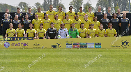 Dortmund's soccer team poses during a team photo shooting of Borussia Dortmund for the new Bundesliga season 2013/2014 in Dortmund, Germany,. Back from left: Dr. Andreas Schlumberger, Andreas Beck, Florian Wangler, Sokratis, Lasse Sobiech, Neven Subotic, Mats Hummels, Marian Sarr, Sven Bender, Frank Graefen, Dr. Markus Braun, Teddy de Beer. Second row from left: Peter Kuhnt, Thomas Zetzmann, Thorben Voeste, Kevin Grosskreutz, Julian Schieber, Marvin Ducksch, Robert Lewandowski, Pierre-Emerick Aubameyang, Marco Reus, Henrikh Mkhitaryan, Peter Krawietz, Zeljko Buvac, head coach Jurgen Klopp. frond row from left: Oliver Kirch, Marcel Schmelzer, Jakub Blaszczykowski, Nuri Sahin, Zlatan Alomerovic, Roman Weidenfeller, Mitch Langerak, Ilkay Guendogan, Koray Guenter, Jonas Hofmann, Sebastian Kehl