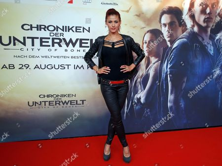 """German model Fiona Erdmann poses for the media during her arrival for the Germany premiere of the movie """"The Mortal Instruments: City of Bones"""" in Berlin, Germany"""