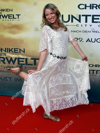 "German actress Sanny van Heteren poses for the media during her arrival for the Germany premiere of the movie ""The Mortal Instruments: City of Bones"" in Berlin, Germany"