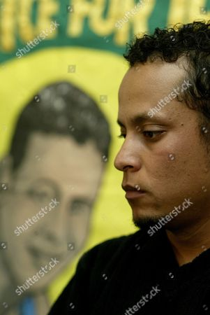 Alessandro Pereira, a relative of John Charles de Menezes, who was shot dead by Counter Terrorism Police in 2005, at a press conference held in response to the Independent Police Complaints Commission report which found that Assistant Commissioner Andy Hayman 'misled' the public