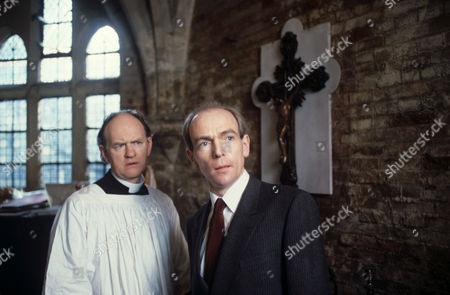 Stock Image of Oliver Ford Davies (left) and Bosco Hogan in 'A Taste For Death'