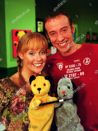 Stock Image of 'Sooty'   TV Presenters: Richard Cadell & Vicki Lee Taylor with Sooty and Sweep.