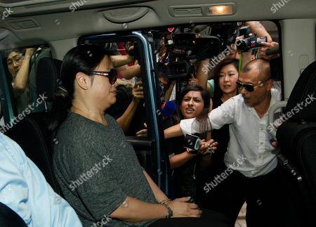 """Former fung shui practitioner Tony Chan Chun-chuen's wife Tam Miu-ching sits in a van to leave after her husband had been convicted and fined at the High Court in Hong Kong, . The former lover of quirky billionaire Nina Wang has been sentenced to 12 years in prison after a Hong Kong court found him guilty of forging her will to claim her multibillion-dollar estate. A High Court judge on Friday called Peter Chan, formerly known as Tony Chan, """"shameless"""" and """"wicked"""" for taking advantage of Wang's trust in him. Chan is a former feng shui master who changed his name from Tony after converting recently to Christianity"""