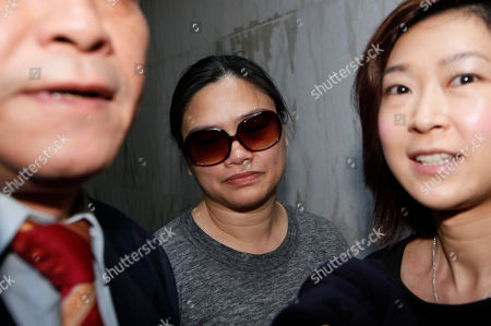 """Tam Miu-ching Former fung shui practitioner Tony Chan Chun-chuen's wife Tam Miu-ching, center, leaves after Chan had been convicted and fined at the High Court in Hong Kong, . The former lover of quirky billionaire Nina Wang has been sentenced to 12 years in prison after a Hong Kong court found him guilty of forging her will to claim her multibillion-dollar estate. A High Court judge on Friday called Peter Chan, formerly known as Tony Chan, """"shameless"""" and """"wicked"""" for taking advantage of Wang's trust in him. Chan is a former feng shui master who changed his name from Tony after converting recently to Christianity"""