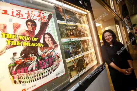 Shannon Lee Shannon Lee, daughter of the late Kung Fu star Bruce Lee, poses in front of a movie poster at a souvenir store for the Lee's memorial exhibition at the Hong Kong Heritage Museum to mark the 40th anniversary of the death of Lee. Lee died on July 20, 1973