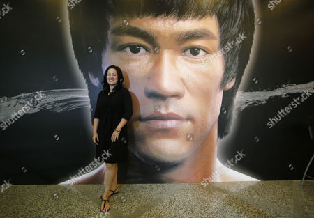 Shannon Lee Shannon Lee, daughter of the late Kung Fu star Bruce Lee, poses in front of a promotional poster for Lee's memorial exhibition at the Hong Kong Heritage Museum, to mark the 40th anniversary of the death of Lee. Lee died on July 20, 1973