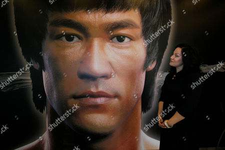 Shannon Lee Shannon Lee, daughter of the late Kung Fu star Bruce Lee, poses in front of a promotional poster for Lee's memorial exhibition at the Hong Kong Heritage Museum to mark the 40th anniversary of the death of Lee. Lee died on July 20, 1973