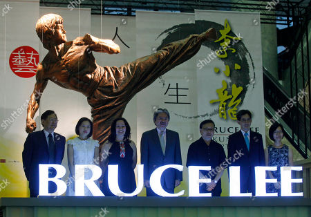 """Shannon Lee, John Tsang Daughter of the late Kung Fu star Bruce Lee, Shannon Lee, third left, poses with Hong Kong Financial Secretary John Tsang, center and other guests during an opening ceremony on Lee's memorial exhibition """"Bruce Lee: Kung Fu, Art, Life"""" at the Hong Kong Heritage Museum marking the 40th anniversary of the death of Lee. The exhibition introduces Lee's achievements and contributions to popular culture and highlight Bruce Lee from his early years in Hong Kong as a child actor and young student of Wing Chun kung fu to his life in US film industry"""