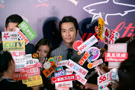 Stock Image of Song Seung-heon South Korean actor Song Seung-heon speaks during the promotional event of the Italian fashion brand store Paul & Shark in Hong Kong