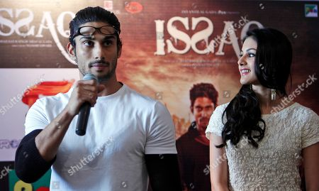 Stock Picture of Indian Bollywood actress Amyra Dastur, right, looks at co-actor Prateik Babbar during a promotional event for their upcoming movie 'Issaq' in Hyderabad, India, . The film will be released on July 26