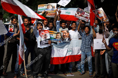 Students of various Indian universities shout slogans against Egyptian Defense Minister Gen. Abdel-Fattah el-Sissi and interim Vice President Mohamed ElBaradei during a solidarity march in support of Egypt's ousted President Mohammed Morsi outside the Egyptian Embassy in New Delhi, India
