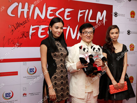 Jackie Chan, Yao Xingtong, Han Sanping Chinese Hollywood actor Jackie Chan poses for the media with Chinese actresses Yao Xingtong, right, and Han Sanping, left, during the inauguration of Chinese film festival, in New Delhi, India