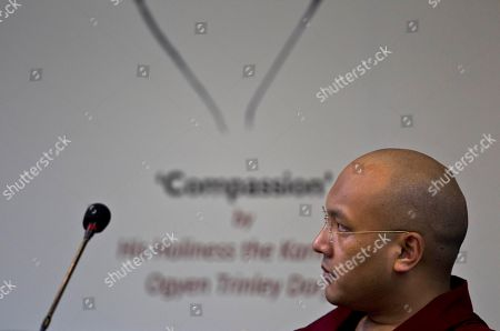 """Ogyen Trinley Dorje The 17th Karmapa Ogyen Trinley Dorje listens during the launch of his book, """"The Heart Is Noble: Changing the World from the Inside Out"""", in New Delhi, India"""