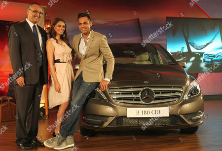 Abhay Deol, Eberhard Kern, Aditi Rao From left, Mercedes Benz India Managing Director and CEO Eberhard Kern, Bollywood actors Aditi Rao and Abhay Deol pose with a Mercedes Benz New B-class diesel car during its launch in Mumbai, India, . The car retails at US$37,856 in Mumbai