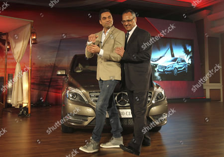 Abhay Deol, Eberhard Kern Mercedes Benz India Managing Director and CEO Eberhard Kern, right and Bollywood actor Abhay Deol share a light moment as they pose for photo in front of a Mercedes Benz New B-class diesel car during its launch in Mumbai, India, . The car retails at US$37,856 in Mumbai
