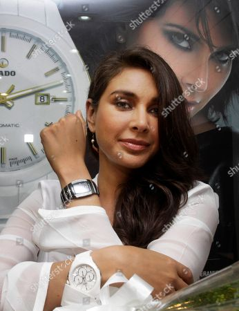 Indian celebrity Lisa Ray poses with a diamond studded watch from Swiss watch maker Rado in Kolkata, India, . The watch is from a new collection and the price range starts from $3800 approximately