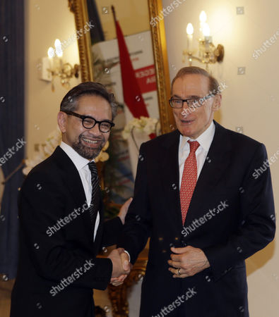Marty Natalegawa, Bob Carr Indonesia Foreign Minister Marty Natalegawa, left, shake hands with Australian Foreign Minister Bob Carr, before a special conference on Irregular Movement of Persons, in Jakarta, Indonesia