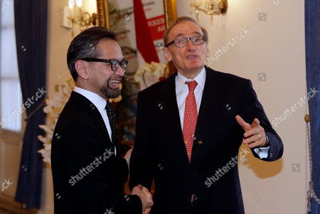 Marty Natalegawa, Bob Carr Indonesia Foreign Minister Marty Natalegawa, left, shakes hands with Australian Foreign Minister Bob Carr before a special conference on Irregular Movement of Persons, in Jakarta, Indonesia