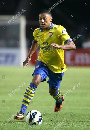 Stock Image of Alex Chamberlain Arsenal's Alex Chamberlain controls the ball during a friendly soccer match against Indonesia Dream Team at Gelora Bung Karno stadium in Jakarta, Indonesia. Arsenal won the match 7-0