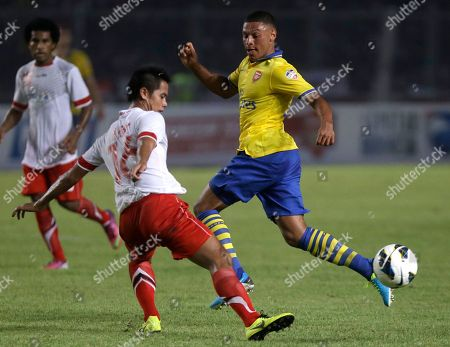 Stock Picture of Alex Chamberlain Arsenal's Alex Chamberlain, right, battles for the ball with Indonesia Dream Team's M. Roby during their friendly soccer match at Gelora Bung Karno stadium in Jakarta, Indonesia. Arsenal won the match 7-0