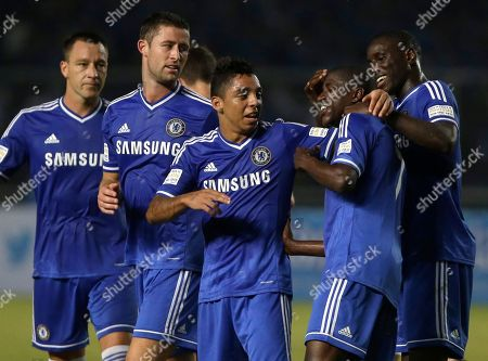 Ramires, John Terry, Gary Cahill, Wallace, Demba Ba Chelsea's Ramires, second right, celebrates with his team mates, from left to right, John Terry, Gary Cahill, Wallace, and Demba Ba after scoring a goal against Indonesia All Stars during their friendly soccer match at Gelora Bung Karno stadium in Jakarta, Indonesia, . Chelsea won the match 8-1