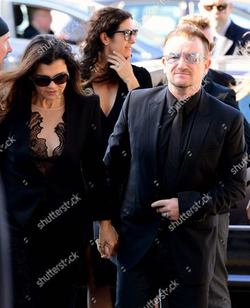 U2 singer Bono, right arrives with his wife Ali Hewson for the funeral of Irish poet Seamus Heaney, at the Church of the Sacred Heart in Donnybrook, Dublin, Ireland, . Ireland mourned the loss of its Nobel laureate poet, Seamus Heaney, with equal measures of poetry and pain Monday in a funeral full of grace notes and a final message from the great man himself: Don't be afraid. Among those packing the pews of Dublin's Catholic Church of the Sacred Heart were government leaders from both parts of Ireland, poets and novelists, Bono and The Edge from rock band U2, and former Lebanese hostage Brian Keenan. Heaney won the Nobel Prize for literature in 1995 in recognition of his wide-ranging writings inspired by the rural wonders of Ireland, the strife of his native Northern Ireland, the ancient cultures of Europe, of Catholic faith and Celtic mysticism, and the immutability of family ties. He died Friday in a Dublin hospital at the age of 74