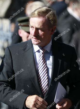 Stock Picture of Irish Prime Minister Enda Kenny attends the funeral of Irish poet Seamus Heaney during a funeral mass at the Church of the Sacred Heart in Donnybrook, Dublin, Ireland, . Ireland mourned the loss of its Nobel laureate poet, Seamus Heaney, with equal measures of poetry and pain Monday in a funeral full of grace notes and a final message from the great man himself: Don't be afraid. Among those packing the pews of Dublin's Catholic Church of the Sacred Heart were government leaders from both parts of Ireland, poets and novelists, Bono and The Edge from rock band U2, and former Lebanese hostage Brian Keenan. Heaney won the Nobel Prize for literature in 1995 in recognition of his wide-ranging writings inspired by the rural wonders of Ireland, the strife of his native Northern Ireland, the ancient cultures of Europe, of Catholic faith and Celtic mysticism, and the immutability of family ties. He died Friday in a Dublin hospital at the age of 74
