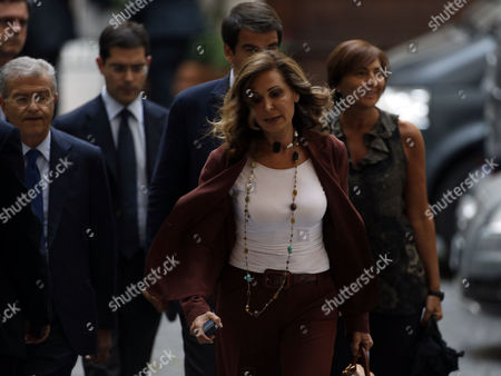 Daniela Santanche', Fabrizio Cicchitto, Daniele Capezzone, Renata Polverini Daniela Santanche', center, former Platform Accomplishment Ministry's undersecretary, arrives at Berlusconi's headquarters in Rome, with People of Freedom (Pdl) center-right party's deputies Renata Polverini, first right, Daniele Capezzone, second left, and Fabrizio Cicchitto, left, minutes after Italy's highest court upheld Berlusconi's tax fraud conviction, and ordered a review of a five-year ban on public office that was part of the lower court's sentence. The court on Thursday confirmed the four-year prison sentence, and ordered another court to determine the length of a public office ban