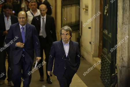 "PDL (People of Freedom) party lawmaker Renato Brunetta, right, and Seantor Renato Schifani, leave Palazzo Grazioli, Silvio Berlusconi's residence in Rome, . Italy's former premier, Silvio Berlusconi, for the first time in decades of criminal prosecutions related to his media empire was definitively convicted of tax fraud and sentenced to prison by the nation's highest court. Judge Antonio Esposito, in reading the court's decision Thursday, declared Berlusconi's conviction and four-year prison term ""irrevocable."" He also ordered another court to review the length of a ban on public office - the most incendiary element of the conviction because it threatens to interrupt, if not end, Berlusconi's political career. The tensely awaited decision puts fresh pressure on Premier Enrico Letta's fragile coalition government, which relies on support from Berlusconi's forces and his own center-left Democratic Party to pass reforms needed to restore market confidence in Italy and haul it out of recession"