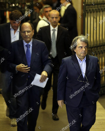 "PDL (People of Freedom) party lawmaker Renato Brunetta, right, and Senator Renato Schifani, leave Palazzo Grazioli, Silvio Berlusconi's residence in Rome, . Italy's former premier, Silvio Berlusconi, for the first time in decades of criminal prosecutions related to his media empire was definitively convicted of tax fraud and sentenced to prison by the nation's highest court. Judge Antonio Esposito, in reading the court's decision Thursday, declared Berlusconi's conviction and four-year prison term ""irrevocable."" He also ordered another court to review the length of a ban on public office - the most incendiary element of the conviction because it threatens to interrupt, if not end, Berlusconi's political career. The tensely awaited decision puts fresh pressure on Premier Enrico Letta's fragile coalition government, which relies on support from Berlusconi's forces and his own center-left Democratic Party to pass reforms needed to restore market confidence in Italy and haul it out of recession"