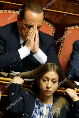 Former Italian Premier Silvio Berlusconi and PDL party mamber Maria Rosaria Rossi, attend a Senate session in Rome where his top aide, Interior Minister Angelino Alfano, faces a vote of non-confidence, . A judge in Naples will evaluate Friday the possible indictment of Berlusconi on charges of corruption for allegedly having paid a rival lawmaker to join his party. Meanwhile a court in Milan is expected later today to reach a verdict in a trial which sees three former Berlusconi aides, Nicole Minetti, Lele Mora and Emilio Fede, accused of procuring women as prostitutes for parties at the then-premier's villa near Milan