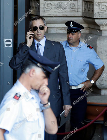 Silvio Berlusconi's lawyer Niccolo' Ghedini uses his mobile phone outside the Court of Cassation building where Berlusconi's case on tax fraud will be decided, in Rome, . Berlusconi's political fate is in the hands of Italy's highest court, which is preparing to hear arguments in the former premier's fraud conviction. Berlusconi has been convicted of tax fraud in a complex TV rights transaction for his Mediaset network, and sentenced to four-years in prison with a five-year ban on public office. This is his final appeal