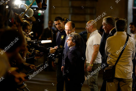 PDL (People of Freedom) party lawmaker Renato Brunetta, foreground, flanked by Senator Renato Schifani talk to journalists outside Grazioli palace, Silvio Berlusconi's residence, in Rome, . Italy's highest court has upheld ex-Premier Silvio Berlusconi's tax fraud conviction, but ordered a review a five-year ban on public office that was part of the lower court's sentence