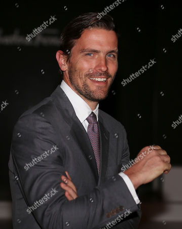 James Ferragamo women's Leather Product Director for the Salvatore Ferragamo group, smiles prior to the start of the Salvatore Ferragamo men's Spring-Summer 2014 collection, part of the Milan Fashion Week, unveiled in Milan, Italy