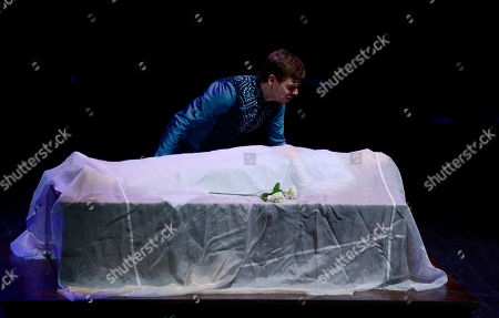 """Made available on Friday, July 12, actors Diego Facciotti, above, in the role of Paris, and Mimosa Campironi, in the role of Juliet, perform in William Shakespeare's """"Romeo and Juliet"""" at the Silvano Toti Globe Theatre in Rome. The Silvano Toti Globe Theatre was built in 2003 with a similar structure to London's Globe Theatre, and it mainly stages English pieces written in the Elizabethan era. The play, on stage from July 10 to July 28, has been produced to mark the theater's 10th anniversary"""