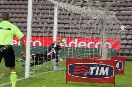 Atalanta's Guglielmo Stendardo, not seen, scores past Cagliari goalkeeper Michael Agazzi during the Serie A soccer match between Cagliari and Atalanta, at the Nereo Rocco Stadium in Trieste, Italy