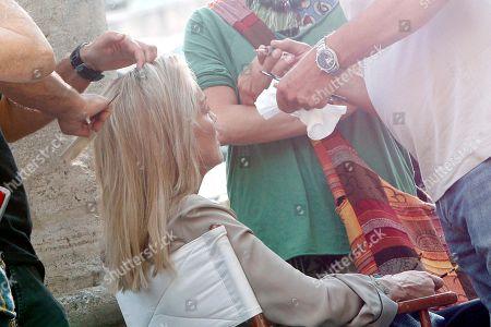 """Sharon Stone Makeup artists prepare actress Sharon Stone for a shoot in the movie """"Un ragazzo d'oro"""", by Italian director Pupi Avati, outside Rome's Santa Maria dei Miracoli Church"""