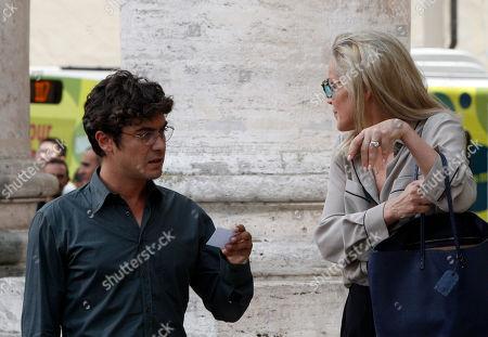 "Sharon Stone Actress Sharon Stone, right, and Italian actor Riccardo Scamarcio act on the set of the movie ""Un ragazzo d'oro"", by Italian director Pupi Avati, outside Rome's Santa Maria dei Miracoli Church"