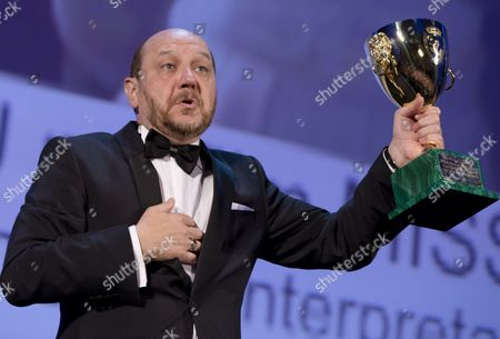 Themis Panou Actor Themis Panou holds his Volpi Cup for Best Actor for his role in the film 'Miss Violence', during the awards ceremony of the 70th edition of the Venice Film Festival in Venice, Italy