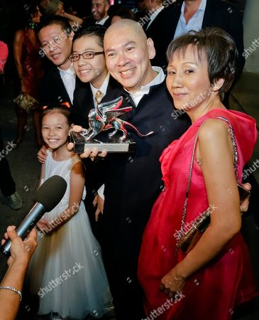 Stock Photo of Tsai Ming-liang, Lee Kang-sheng, Lee Yi-chieh, Lee Yi-cheng, Lu Yi-ching Director Tsai Ming-liang, second from right, holds the Grand Jury Prize for his movie 'Stray Dogs', as he leaves with the cast, from left, actors Lee Kang-sheng, Lee Yi-chieh, Lee Yi-cheng, and Lu Yi-ching, at the end of the awards ceremony of the 70th edition of the Venice Film Festival in Venice, Italy